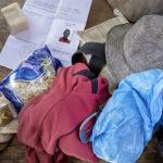 Kleidung, Notrationen, Waschpulver und ein Dokument der malischen Einwanderungsbehörde: der Inhalt des Rucksacks vom Migranten Doudou Sonko.